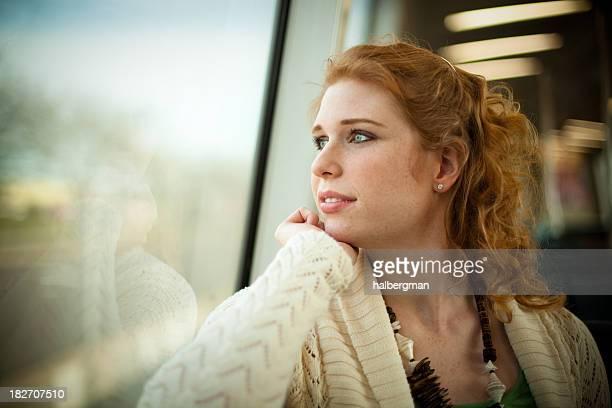 Girl Riding a Commuter Rail Train
