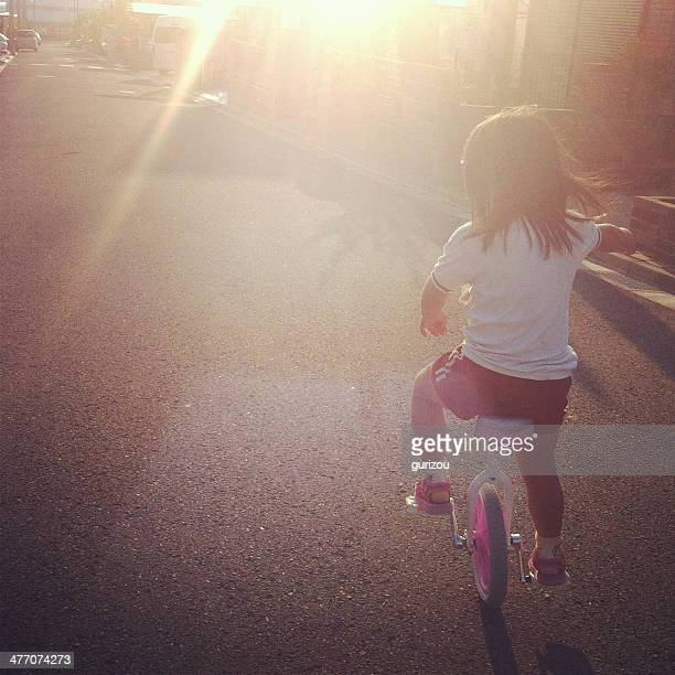 girl riding a unicycle