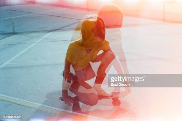 Girl Riding Barefoot On Skateboard