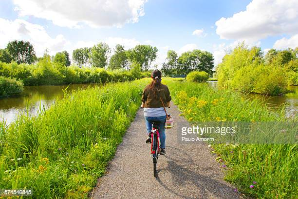 A girl riding bicycle during summer