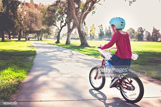 Girl Riding Bike in Park