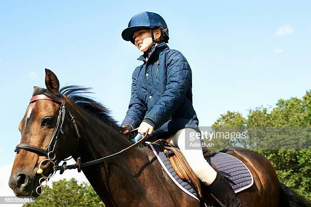girl riding horse in countryside - riding boot stock pictures, royalty-free photos & images