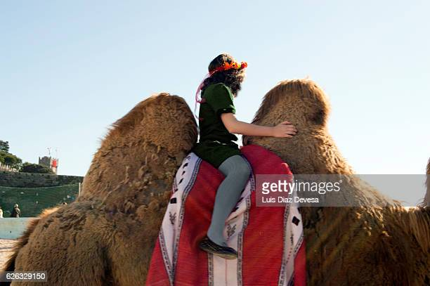 girl riding on a camel.