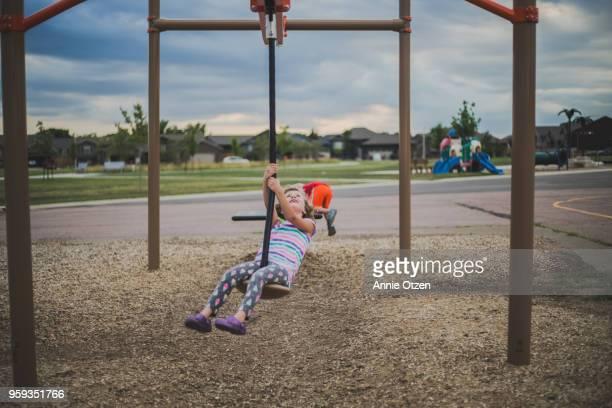 Girl Riding Playground zip line