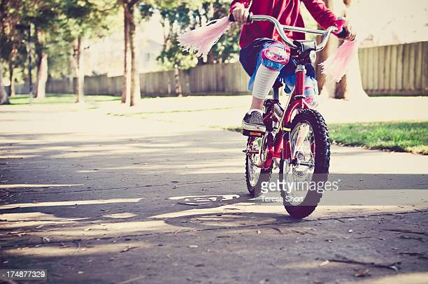 Girl Riding Red Bike