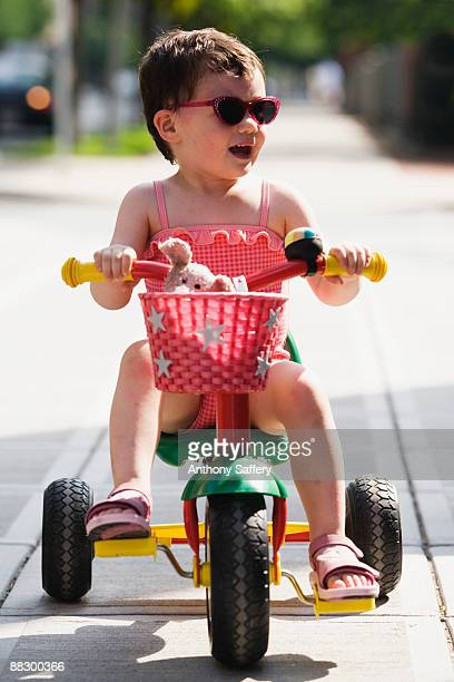 Girl riding tricycle