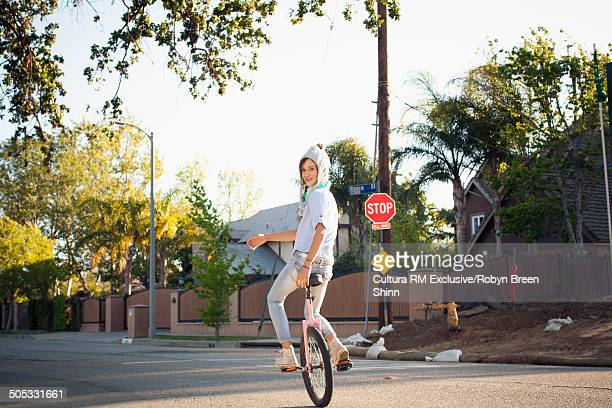 Girl riding unicycle