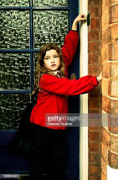 Girl ringing a doorbell
