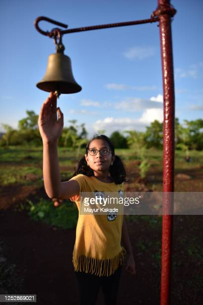 girl ringing temple bell - bell stock pictures, royalty-free photos & images