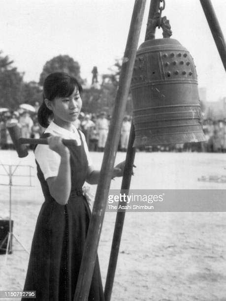 A girl rings the Peace Bell during the Peace Memorial Ceremony on the 17th anniversary of the Hiroshima ABomb dropping at Hiroshima Peace Memorial...