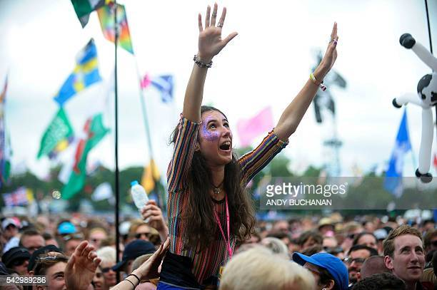 A girl rises above the Pyramid Stage crowd on day four of the Glastonbury Festival of Music and Performing Arts on Worthy Farm near the village of...