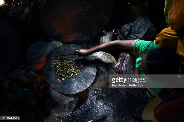 A girl roasts coffee beans in the family house on December 9 2012 in Bonga Ethiopia The family runs a small coffee show The Kaffa region is known for...
