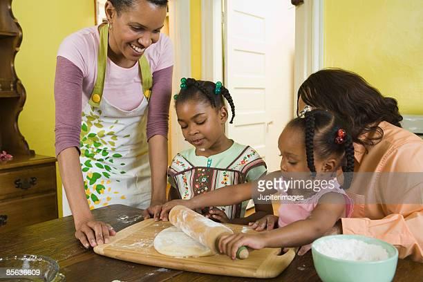 Girl rolling dough