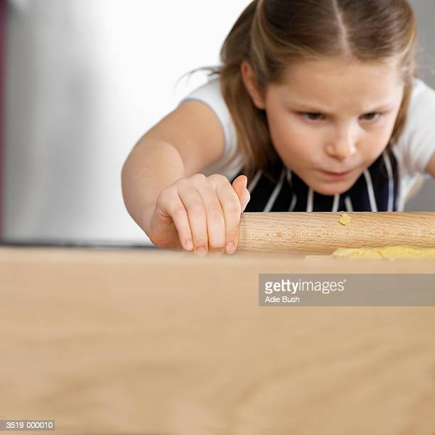 Girl Rolling out Cake Mixture