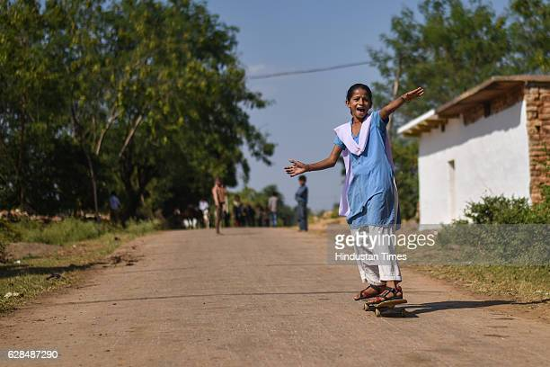A girl rolls down the road in her school uniform on October 26 2016 in Janwaar India Thanks to a German community activist and author Ulrike Reinhard...
