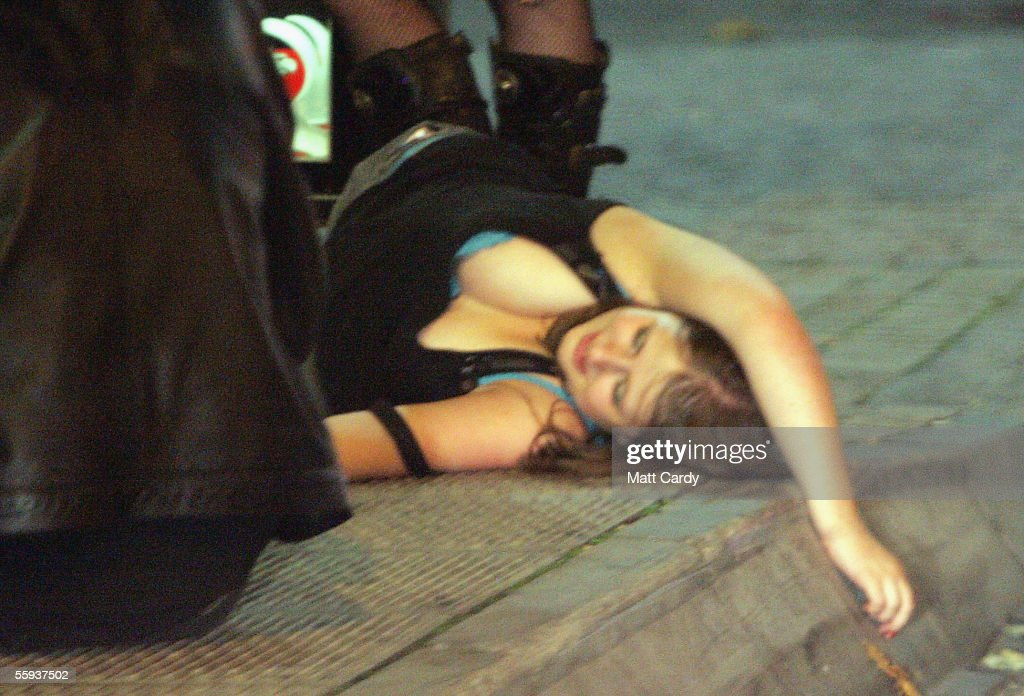A girl rolls on the ground in Bristol City Centre on October 15, 2005 in Bristol, England. Pubs and clubs preparing for the new Licensing laws due to come into force on November 24 2005, which will allow pubs and clubs longer and more flexible opening hours.Opponents of the law believe this will lead to more binge-drinking with increased alcohol related crime, violence and disorder while health experts fear an increase in alcohol related illnesses and alcoholism.