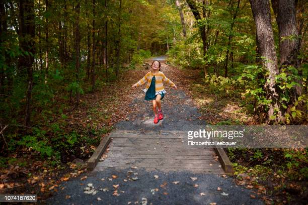 girl running along a footpath, united states - skipping along stock pictures, royalty-free photos & images