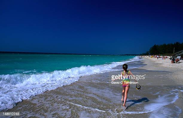 girl running along turtle beach, siesta key. - siesta key stock photos and pictures