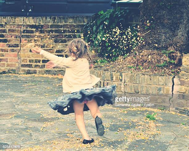 girl running at back yard - little girls up skirt stock photos and pictures