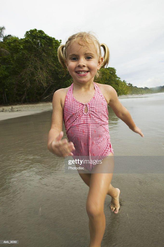 Girl running at the beach : Foto de stock