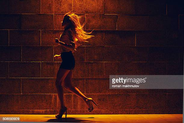 girl running at the street - high heels short skirts stock pictures, royalty-free photos & images