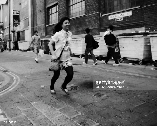 Girl running Brick Lane Market - East London