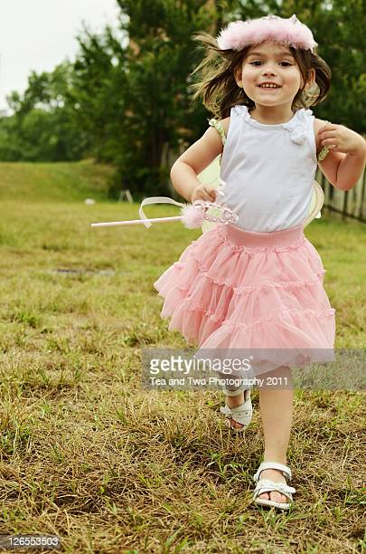 Girl running in grass
