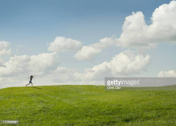 Girl running in rural landscape