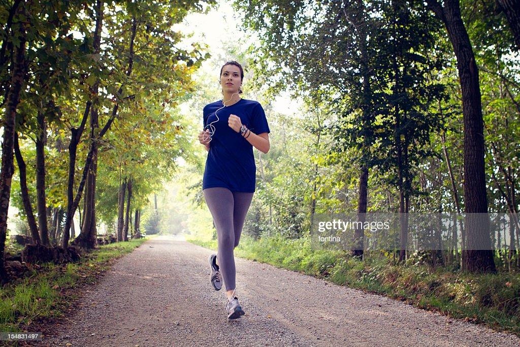 girl running in the morning : Stock Photo