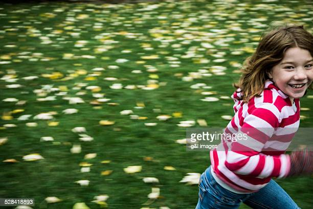 girl (7yrs) running in yard