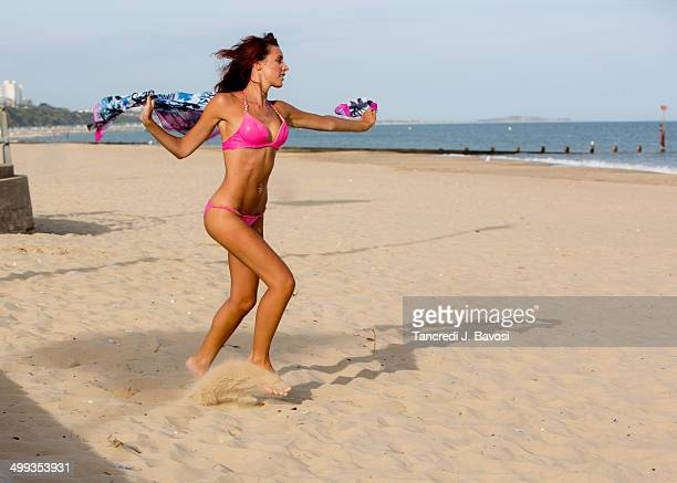 girl running on the beach - bavosi stock photos and pictures