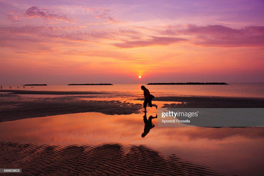 Girl running on the beach : Stock Photo