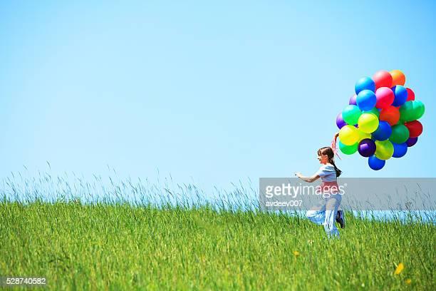 女の子 にして、フィールドに風船