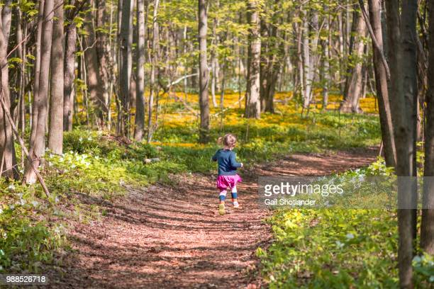 Girl running on the Forest Path
