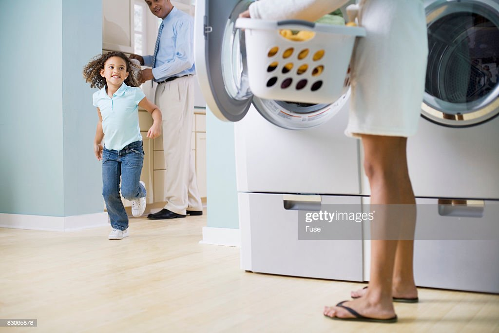 Girl Running To Mother in Laundry Room : Foto stock