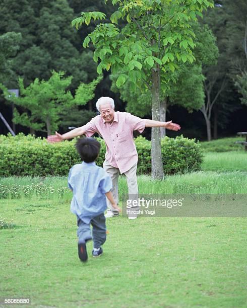 A girl running toward grand father