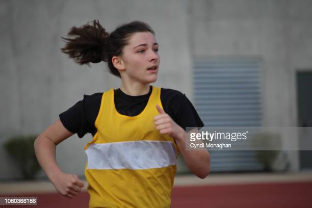 Girl Running Track and Field