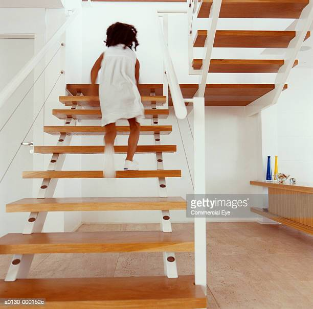 Girl Running up Stairs at Home