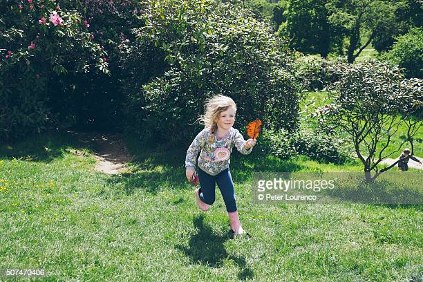 Girl running with a leaf