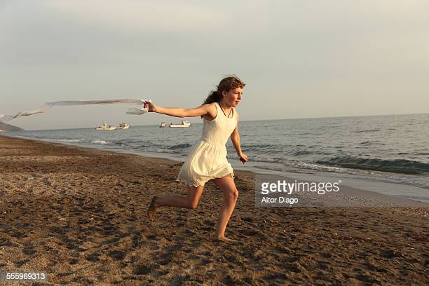 girl running with a white band in her hand. - girl band stock pictures, royalty-free photos & images