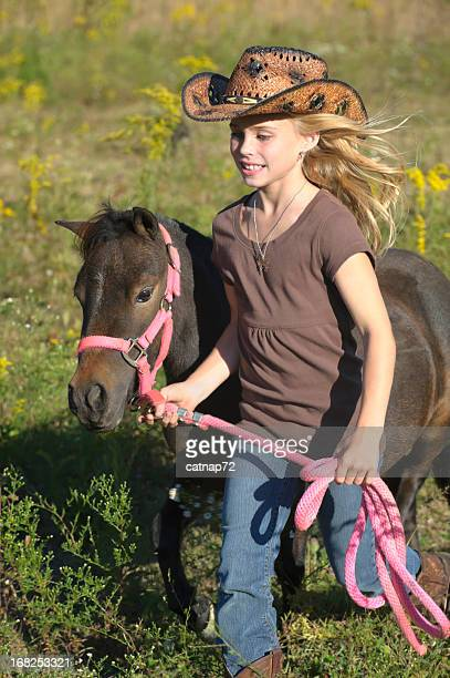 Girl Running with Horse in Summer Goldenrod Field