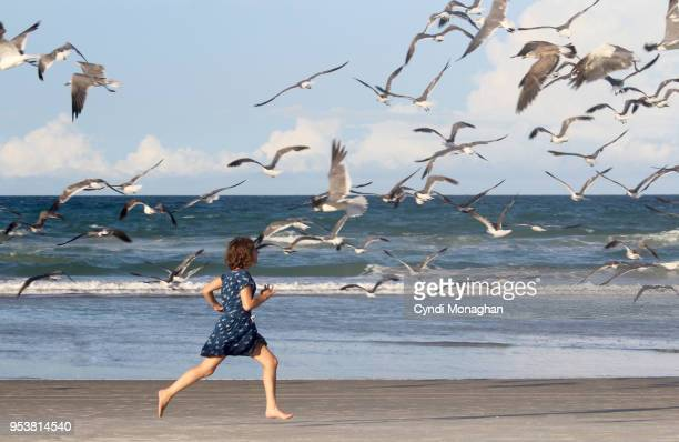 Girl Running with Seagulls