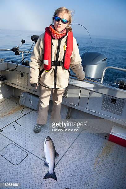 Girl salmon fishing