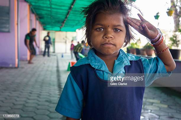 A girl salutes the camera at the Chingari Trust's rehab center for children November 29 2012 in Bhopal India The Chingari Trust serves as a sanctuary...