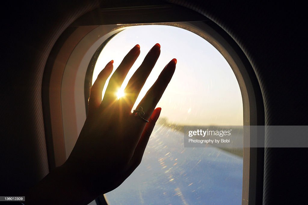 Girl say good bye into cabin beside window : Stock Photo