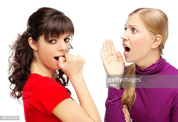 Girl says something to her friend.White background