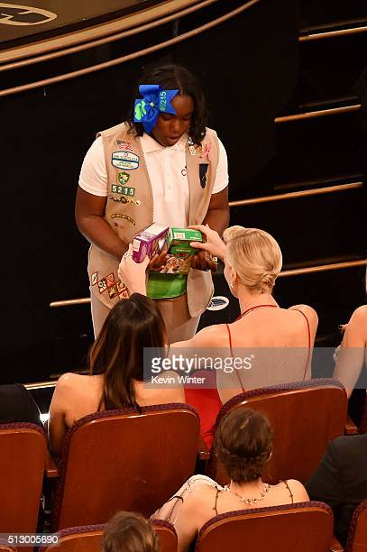 Girl Scout sells cookies to audience members including actress Charlize Theron during the 88th Annual Academy Awards at the Dolby Theatre on February...