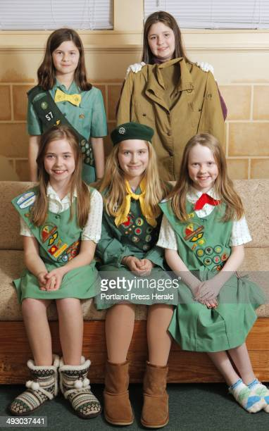 Girl Scouts from Troop 42 model Girl Scout uniforms from different decades Front row left to right Madison Weatherbee Isabella Chandler and Kylie...