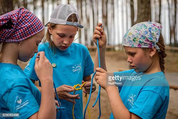 Girl scouts learn how to tie knots in Ukrainian scout training camp Kiev region Ukraine