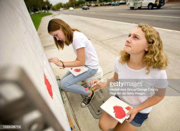 Girl Scouts Patricia Laukat at left and Alyssa Johnson both 14 begin work on a utility box on Garden Grove Blvd and Main where they sketch out a...